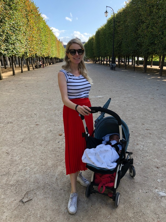 Blonde girl at Palais Royal in Paris with baby pram