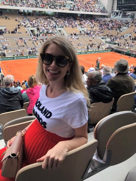 Blonde girl pregnant in Paris at Roland Garros